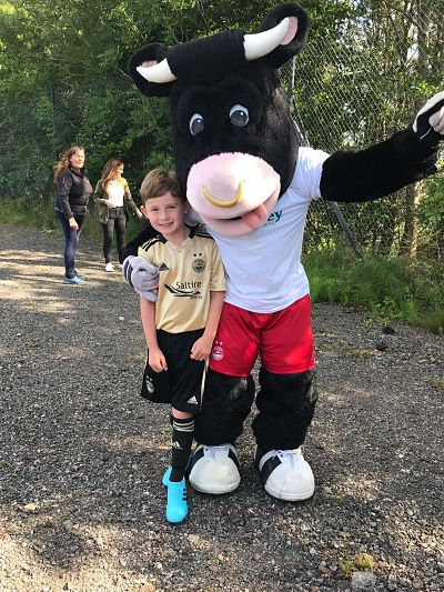 Angus the Bull supports Osprey charity football fundraiser image